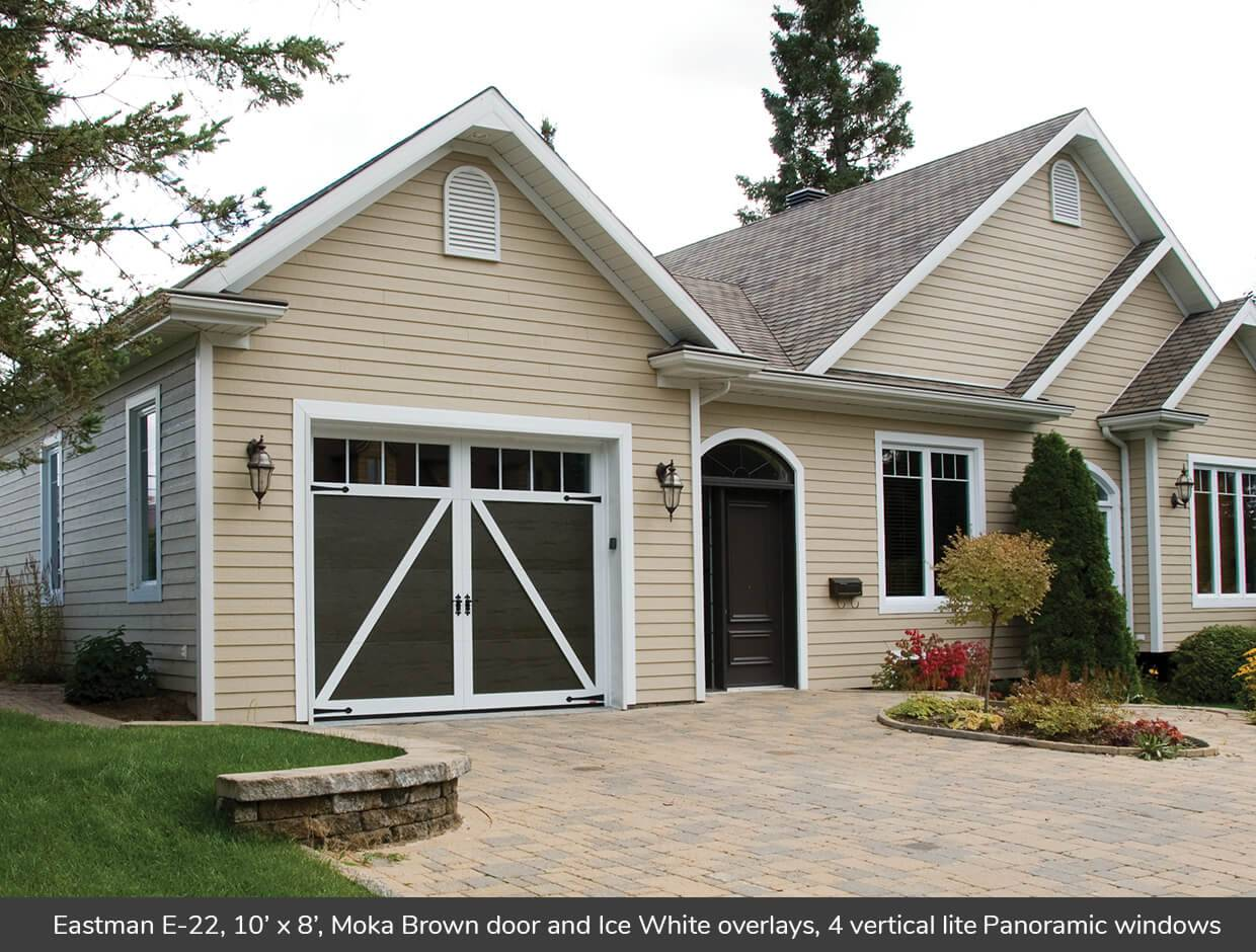Eastman E-22, 10' x 8', Moka Brown door and Ice White overlays, 4 vertical lite Panoramic windows
